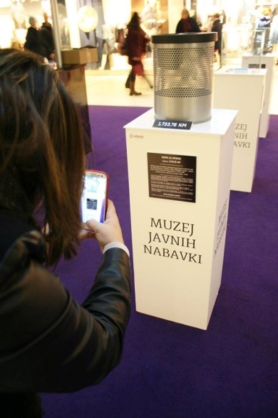 "Citizen takes photos of $938 wastebasket bought by government, during ""We Pay the Price"" campaign in Sarajevo."