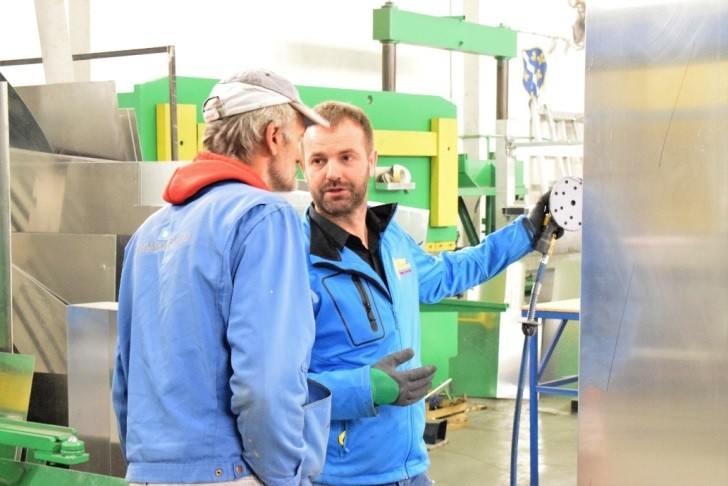 Suad Beslic (R) spends every available moment with his workers in his factory in Zivinice, Bosnia and Herzegovina.
