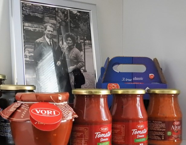 Vori's products in front of a photo of the founder and his wife