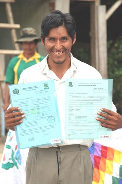 Julio Jankoña, a Bolivian farmer in the Chapare region of Bolivia, proudly shows his legal land titles.