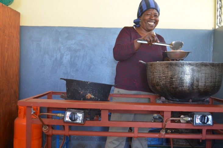 Genèse Laguerre cooks with propane (LPG) for the first time at the EFACAP school in Kenscoff.