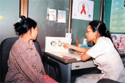 A housewife is educated from a RHAC clinic doctor.