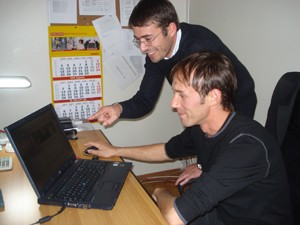 University of Prishtina students Fatmir Halili and Islam Pepaj looking at the university's new web site