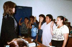 A Managua judge swears in a jury for a public, oral trial.