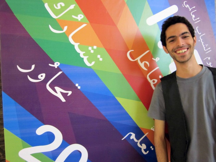 Al Zaghal stands beside his winning poster