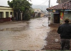 The capital of Honduras, Tegucigalpa, was flooded by Hurricane Mitch in October 1998.
