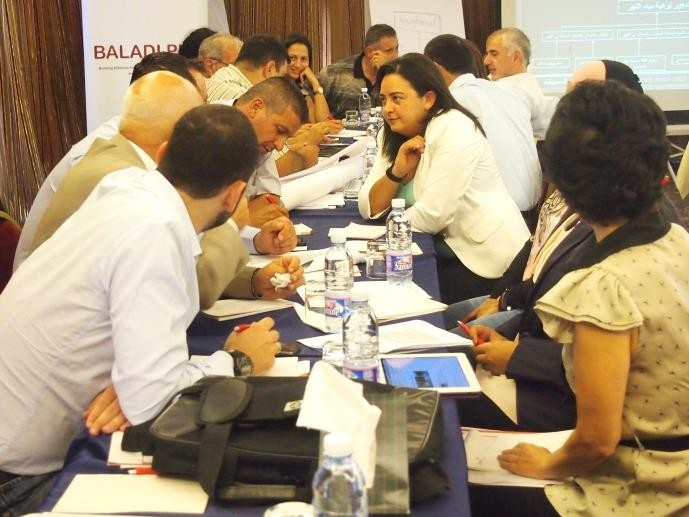 Josephine Zogheib discusses elements of a successful proposal with colleagues during a USAID workshop.