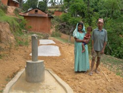 This family in Kaski, a mountainous region of central Nepal, benefited from a USAID program installing multi-use water systems.