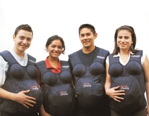 "Young women and men in Guatemala try on ""pregnancy suits"" as part of reproductive health training for youth"
