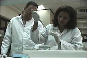 Dr. Mireya Matamoros, Director and Miguel Fortín, Analyst, at the genetics lab in the Forensic Medicine Directorate.