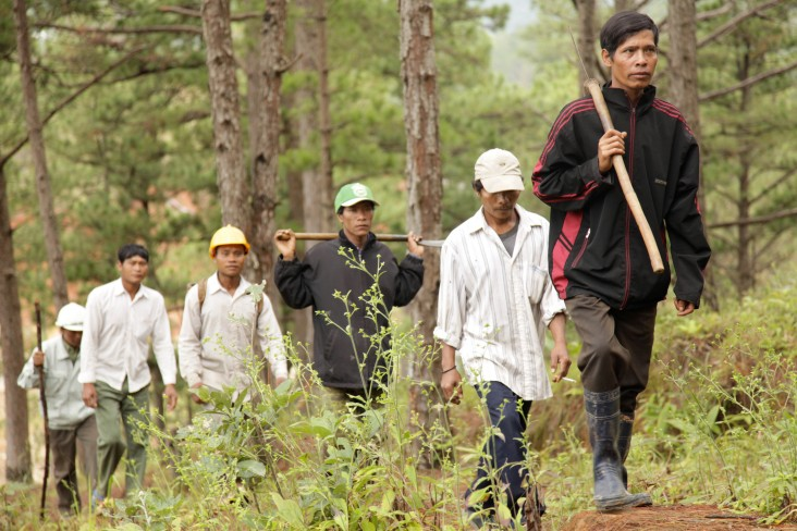 Vietnamese men on a forest path