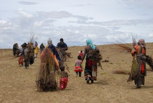 The beginnings of reformation-turning a desert into grasslands: Villagers carry seedlings to start re-plantation activities that