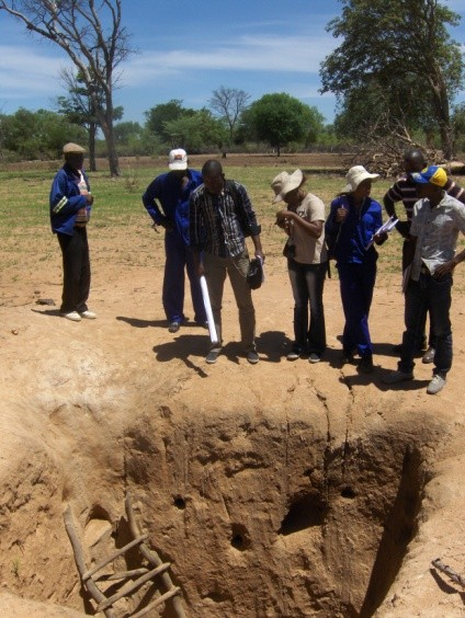 Cunene CPU officials and World Learning staff inspect a new location for a water well that will provide inhabitants and animals