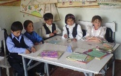 Children at Yazgulam's School No. 22 enjoy interactive lessons, part of innovative changes suggested by a USAID education initia