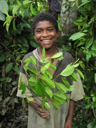 A young resident of Bajo Mira proudly displays the area's rich habitat.