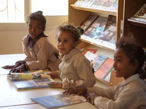 Seven-year-old Do'a Ali (center) has a favorite place in the new Hamata School in Egypt: the library.