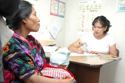 A Guatemalan indigenous woman discusses options with a family planning counselor at a Ministry of Health facility in Chichicaste