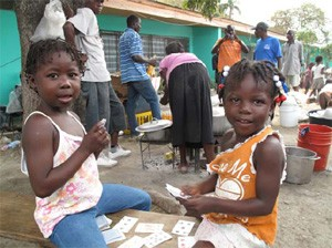 Children playing cards in a child friendly space in Jacmel.