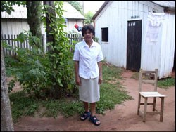 Tomasa, a local midwife, at the entrance of her house in Caaguazu.