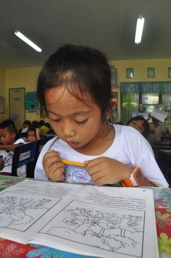Young Girl in Rural Philippines Braves the Sea to Read and Learn