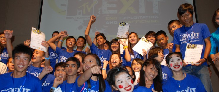 Students from Burma and Thailand celebrate after performing anti-trafficking awareness scenes and graduating from the first-ever
