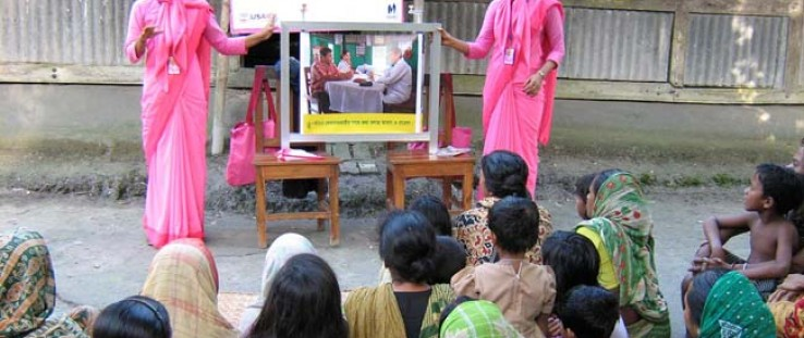 A courtyard meeting conducted by the Social Marketing Company trains expectant and new mothers on newborn care.