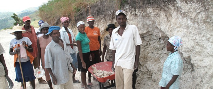 A key constraint to agricultural development in Fond Baptiste, Haiti, is the poor condition of rural roads. Above, members of th