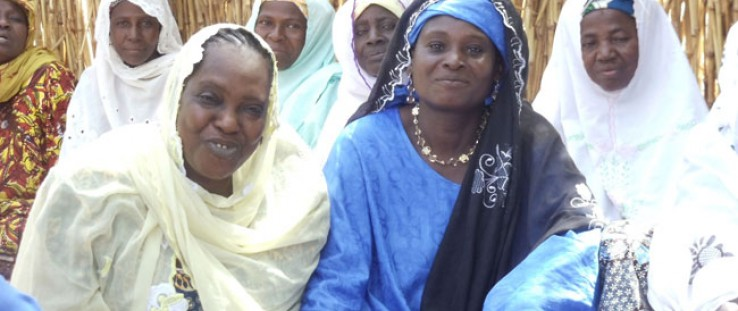 Seated among other women from the village, Madame Moringa poses for a photo in April 2012.
