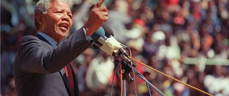 Anti-apartheid leader and African National Congress member Nelson Mandela speaks at a funeral for 12 people who died during town