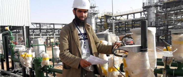 Bilel Boutadjine, an engineer and former University of Mentouri Constantine (UMC) student, is pictured at his job at KIS Co. Bil