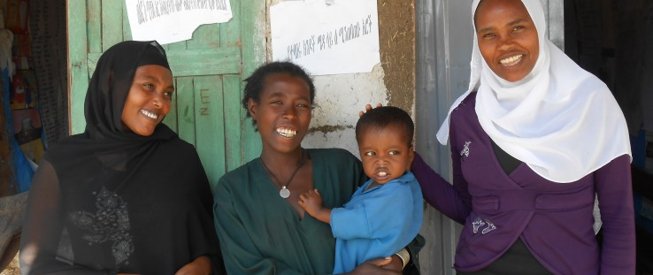 Enanit Metiku holds her son, Tazen, flanked by Belaynesh Fentie, left, and Tegegnech Tsehay, health extension workers.