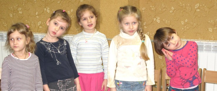 "Four- and 5-year-old girls from ""Kalynka"" group attend a music class."