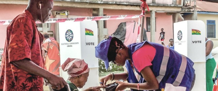 A 90-year-old woman is biometrically verified to vote on Election Day in Ghana.