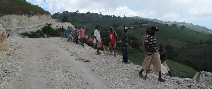 Members of the Fond Baptiste community carry out labor-intensive road maintenance. credit: Jacob Greenstein