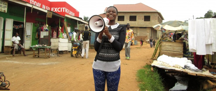 A peer educator mobilizes clients for outreach services in Kawempe.
