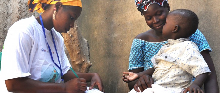 Djenebou Keita, a community health worker, tests a 2-year-old boy for malaria in Mali.