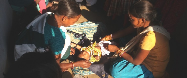 A community health worker prepares to weigh a newborn at his home in the Haridwar district of Uttarakhand state.