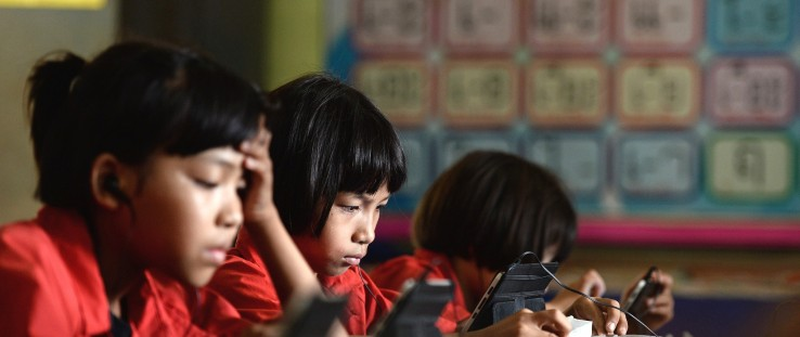Students use tablet computers at the Ban San Kong school in Mae Chan, northern Thailand.