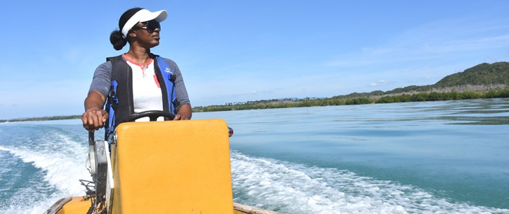 Game warden Venis Bryan patrols the Bluefields Bay Fish Sanctuary to protect marine wildlife.