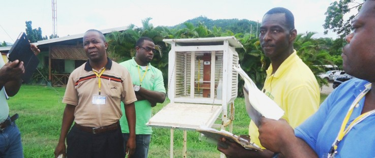 Through training provided by a USAID climate change program, agriculture extension officers learn to interpret weather readings.