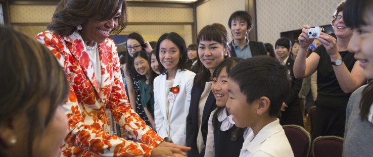 First lady Michelle Obama greets students following the Let Girls Learn announcement at the Iikura Guest House in Tokyo, Japan.