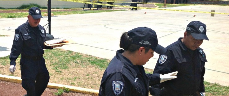 In the city of Cuernavaca, police officers participate in a field exercise to preserve and protect crime scenes, which includes