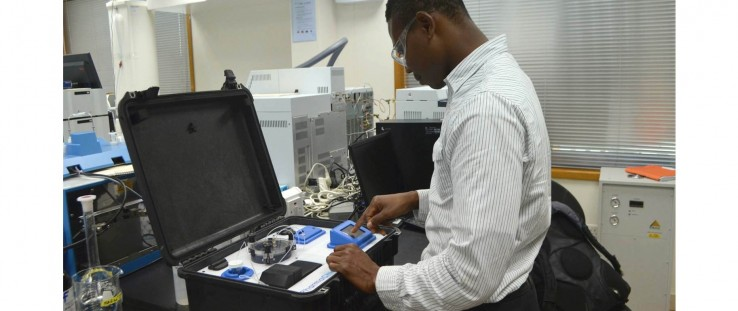 A Ghanian technician in Accra uses PharmaChk to test malarial drug quality.