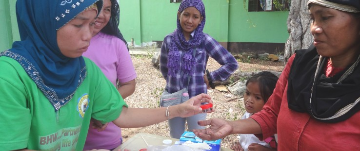 Informal laboratory workers in Basilan get supply of sputum cups for distribution to community members with TB symptoms.