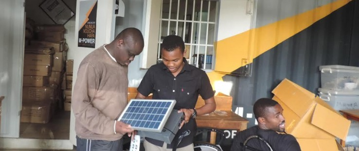 Steve Wasira, left, visits Off Grid Electric, a partner of the Power Africa sub-initiative, Beyond the Grid.