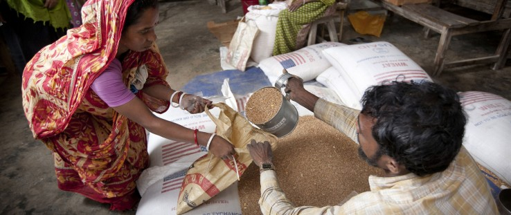 A woman receives grains in Bangladesh