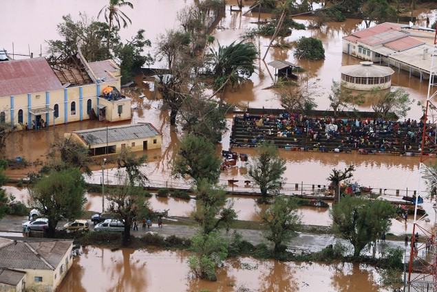 Residents gather stranded on the stands of a stadium in a flooded area of Buzi, central Mozambique, on March 20, 2019, after the passage of cyclone Idai.