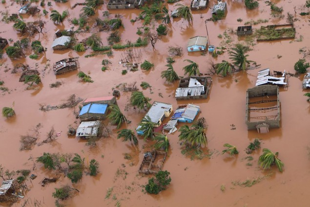 Houses in a flooded area of Buzi, central Mozambique, on March 20, 2019, after the passage of cyclone Idai. International aid agencies raced on March 20 to rescue survivors and meet spiralling humanitarian needs in three impoverished countries battered by one of the worst storms to hit southern Africa in decades. Five days after tropical cyclone Idai cut a swathe through Mozambique, Zimbabwe and Malawi.Photo by ADRIEN BARBIER / AFP