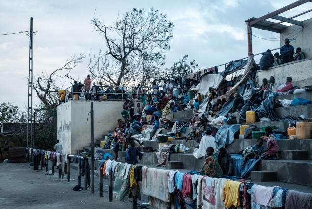 People stay in shelter at the stands of Ring ground in Buzi, Mozambique, on March 23, 2019, after the area was hit by the Cyclone Idai.