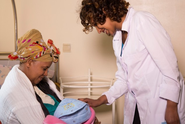 Midwife Yodit Meseret does a post-delivery check up with a new mother, Yeshi Getachew, at the Bole Health Center.